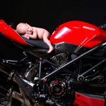 Baby on red Ducatti