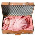 Adorable baby in suitcase